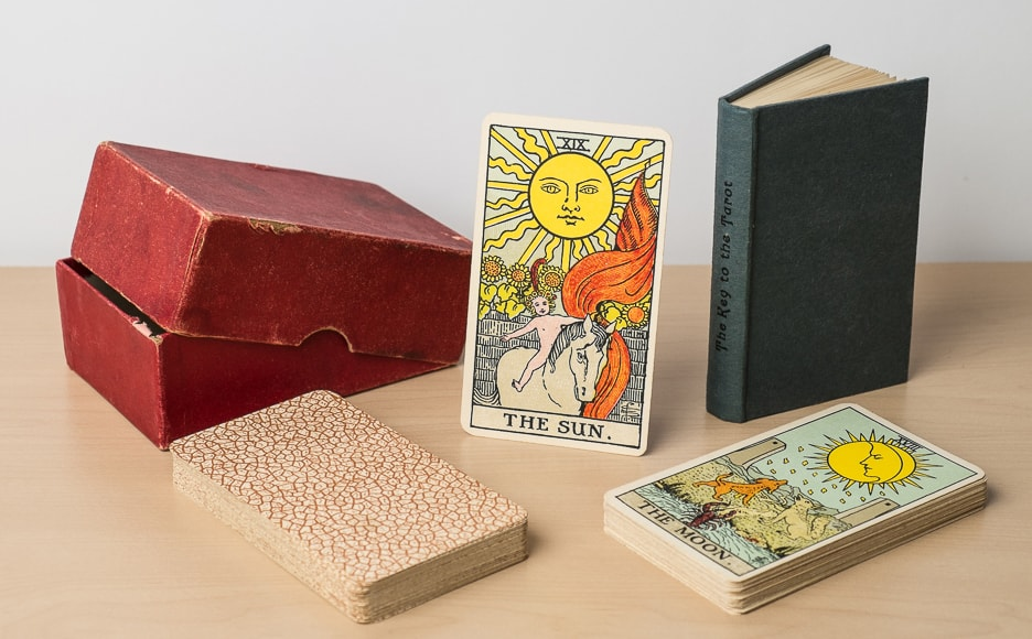1930's Rider tarot deck displayed with book and box